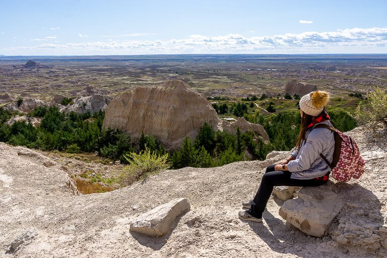 Kristen overlooking badlands national park from end of notch trail