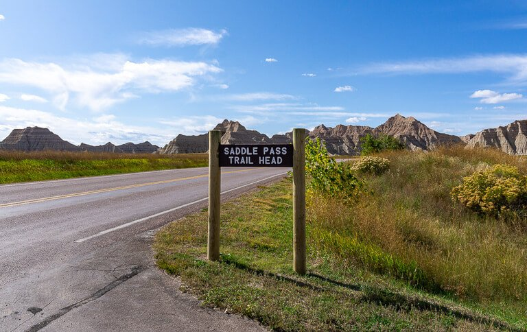 Saddle pass trail head sign post at badlands