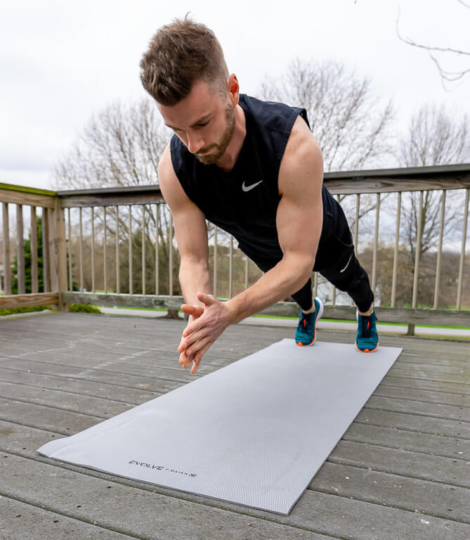 Tabata exercise Mark performing a clapping push up on a yoga mat