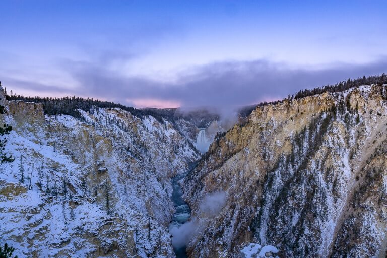 Awesome sunrise purple pink sky over Yellowstone lower falls national park