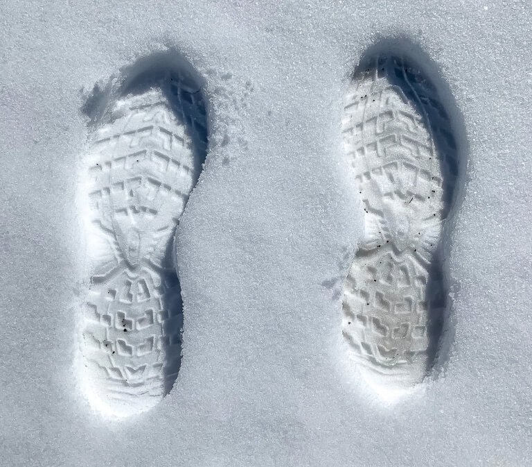 Deep footprints in fresh snow at yellowstone national park hiking trails 4 days itinerary