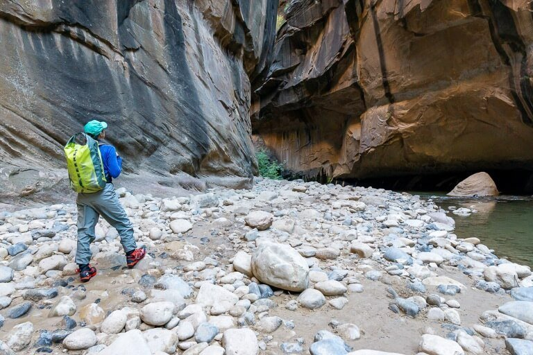 Kristen hiking the narrows Zion national park Utah hiking tips for beginners plan and prepare waterproof clothing