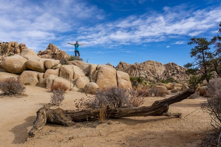 Kristen on top of rocks in hidden valley Joshua Tree national park
