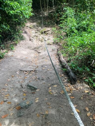Koh Adang hiking trail is steep and has ropes to hold onto at various points