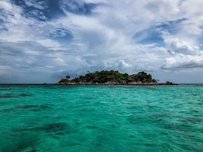 Small island on turquoise waters near Koh Lipe Thailand