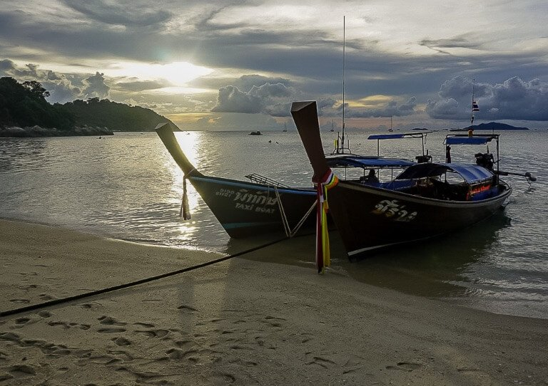 Long tail wooden boats in Thailand at sunset amazing sky