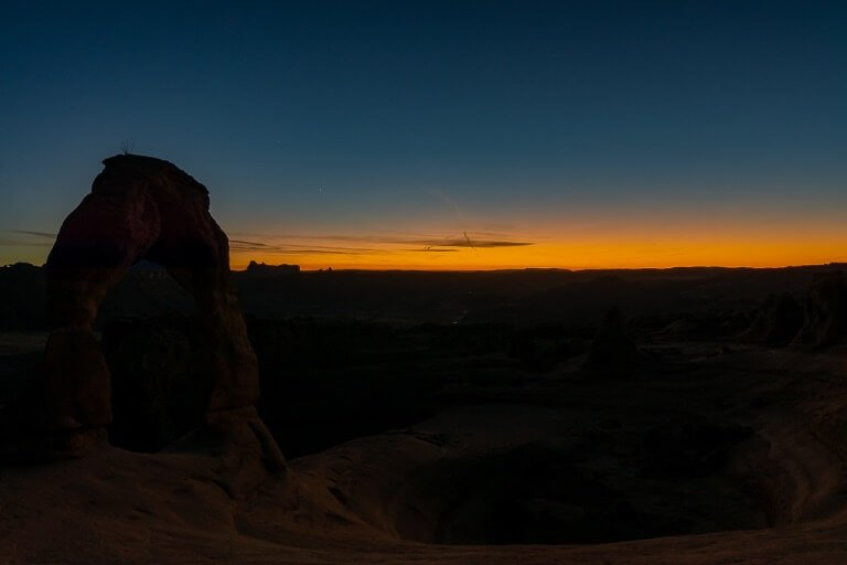 Moab Utah rock formation at twilight with stunning colors in the distant horizon