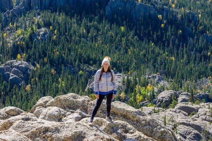 Kristen at the summit of Black Elk Peak Custer State Park South Dakota