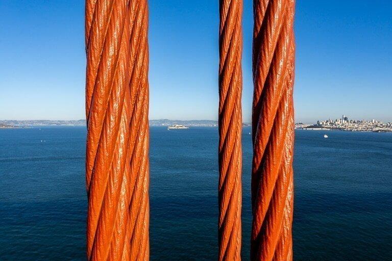 Alcatraz and San Francisco between cables on bridge