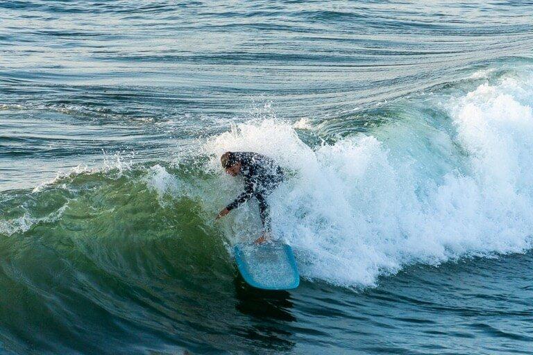 Ocean beach San Diego man surfing a nice wave