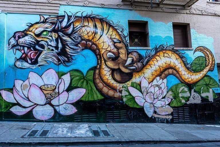 Tiger serpent mural on a wall in San Francisco chinatown
