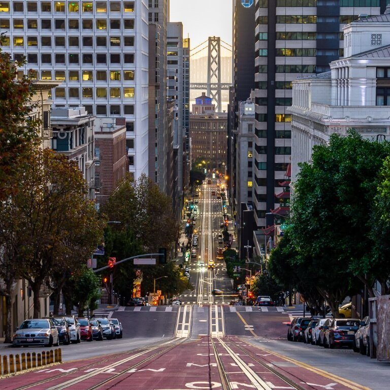 Spectacular san Francisco photography location california & powell intersection view of tram line and Oakland bridge in background
