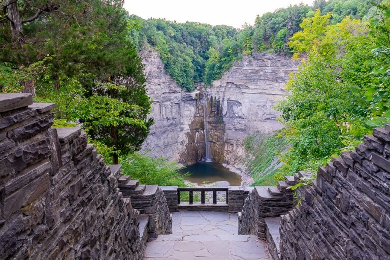 Taughannock Falls from overlook stairs and green foliage in summer Ithaca ny state park