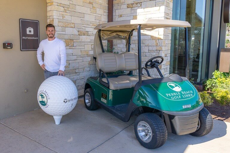 Mark at Pebble Beach golf club next to golf cart in Monterey California