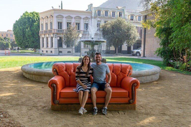 Mark and Kristen sat on the friends sofa at Warner Bros movie studio tour in Los Angeles California best things to do