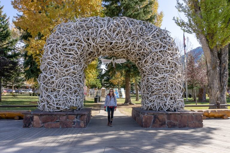 Kristen stood underneath an arch made of antlers in Jackson Hole