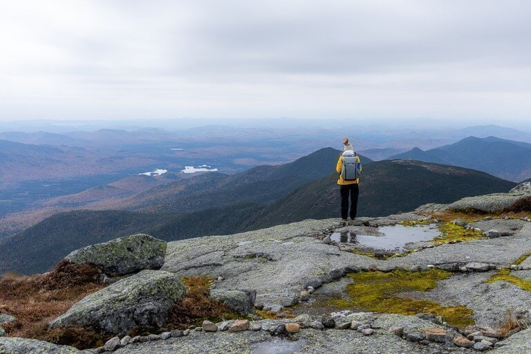 Kristen at Mount Marcy summit in New York Adirondacks with peak design everyday backpack